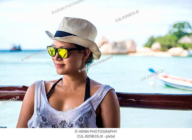 Portrait of woman wearing hat and sunglasses looking away, Koh Tao, Gulf of Thailand, Thailand