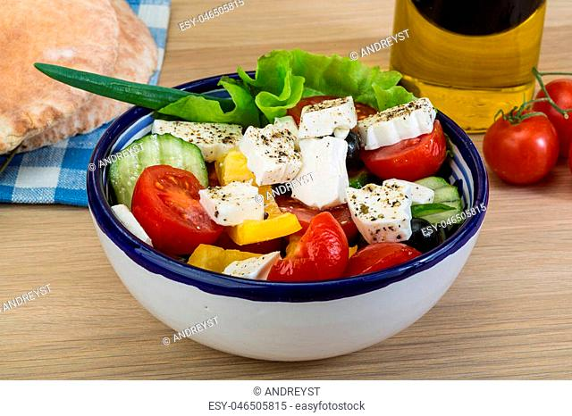 Traditional Greek salad with feta cheese and fresh vegetables