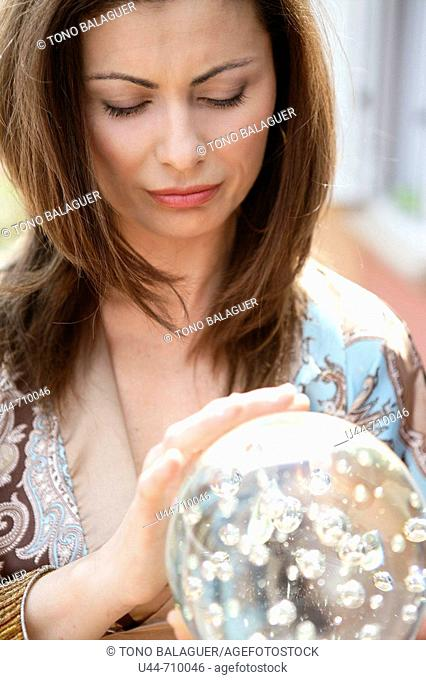 Woman with a cristal ball reading the future
