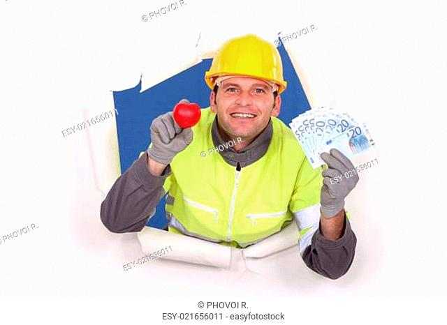 A construction worker showing his cash