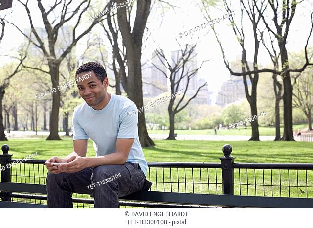 Man sitting on bench in Central Park