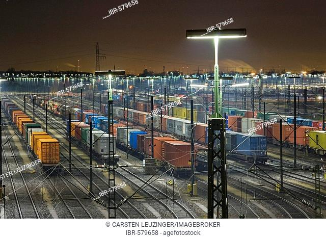 Parked freight trains at Maschen railroad shunting yard near Hamburg at night, Lower Saxony, Germany