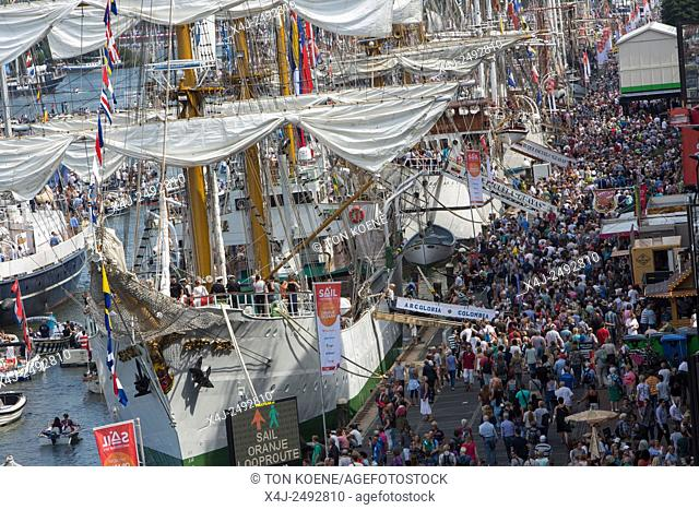 crowds visiting Sail 2015 in the ij-haven in Amsterdam