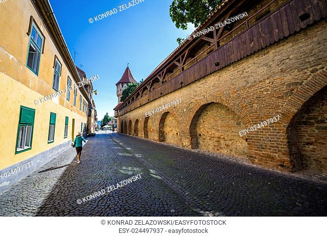 Street with Carpenter's Tower on background in Sibiu city in Romania