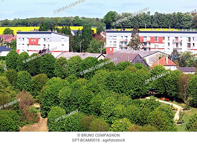 HOUSING PROJECT BEHIND A TREE-FILLED PARK, RUGLES, EURE 27, UPPER NORMANDY, FRANCE, EUROPE