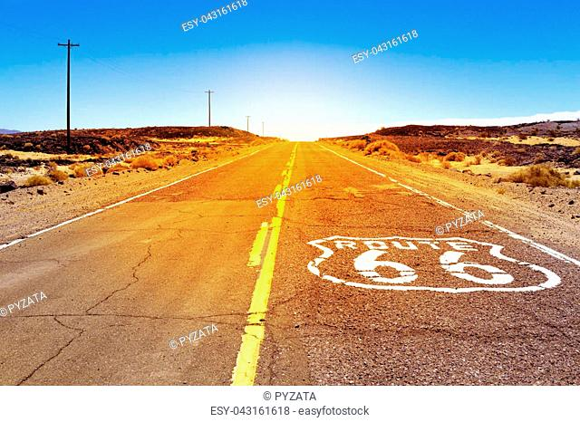 Iconic Route 66 sign on the road in American desert land