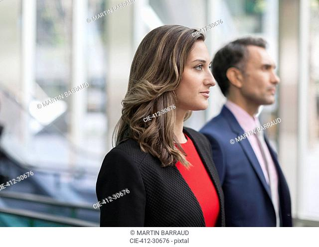 Pensive corporate businesswoman looking away