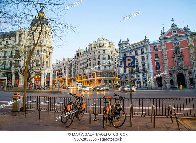 Bike parking at dawn. Alcala street, Madrid, Spain