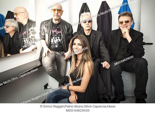 The Decibel (Enrico Ruggeri, Fulvio Muzio and Silvio Capeccia) and the showgirl Alessia Ventura in the dressing room before being interviewed by the journalist...