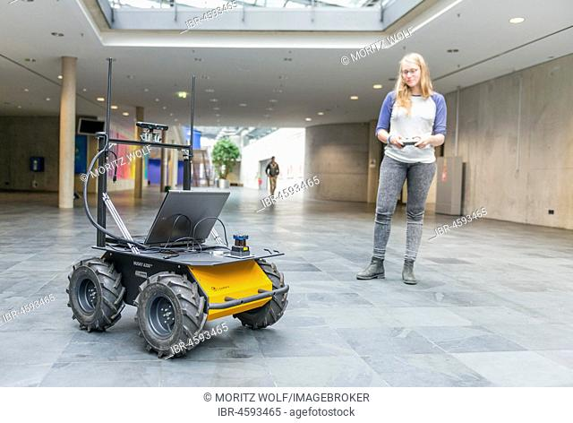 Student controls a robot car, autonomous driving, University of Applied Sciences Munich, Bavaria, Germany