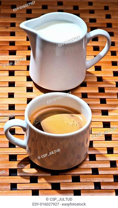 cups of coffee and milk on wood rack