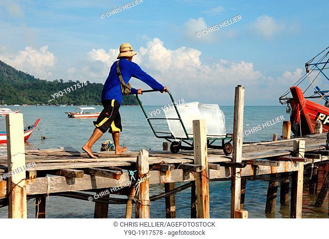 Delivering or Loading Ice onto Fishing Boat at Telok Pahang Fishing Village Penang Malaysia