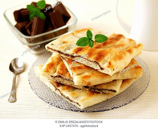 """""""""""""""""""""""Coca"""""""" with chocolate. Typical food from Catalonia, Spain"""