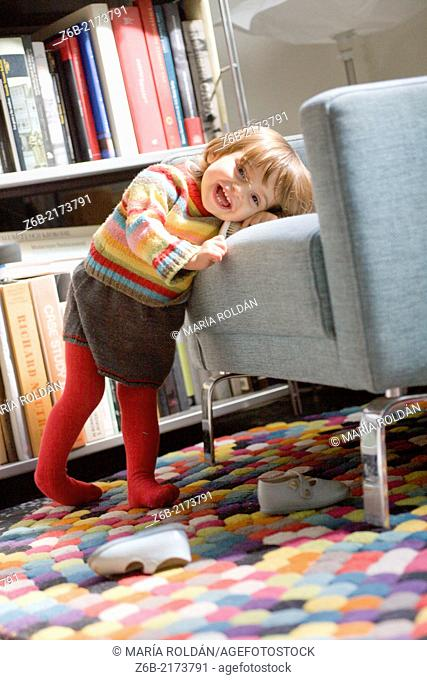 Baby girl, 20 months, pullover, skirt, Knitwear, tigths, Barefoot, shoes, bookshelves, Armchair, brush, carpet