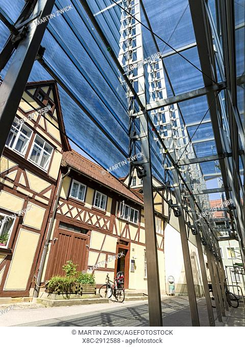 Traditional half timbered medieval house and contemporary glass and steel architecture in the Old Town. Bamberg in Franconia, a part of Bavaria
