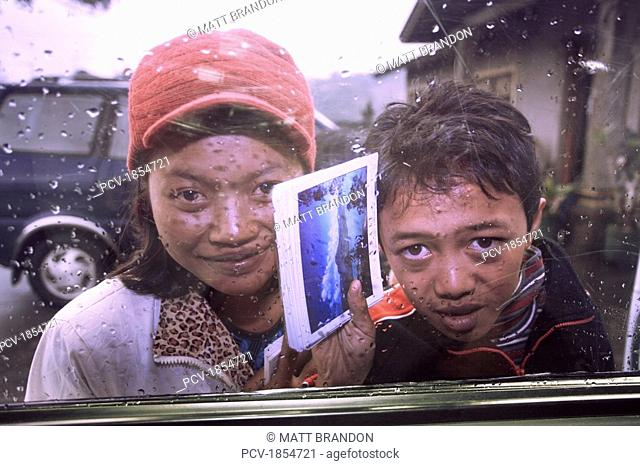 Kids selling postcards