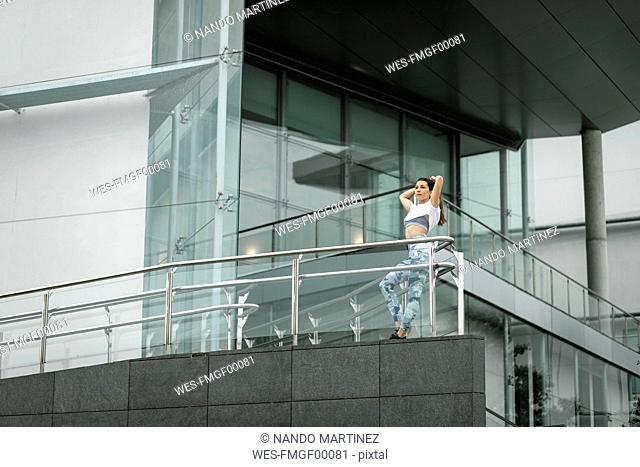 Fit young woman in the city hving a break