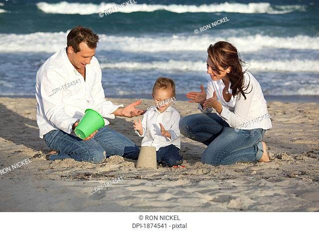 Fort Lauderdale, Florida, United States Of America, A Family Playing In The Sand On The Beach