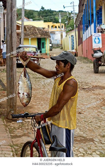 Man with a fish, Street with cobblestone, Oldtimer, Trinidad Cuba