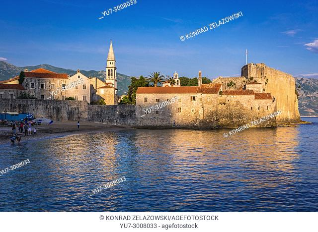 Old Town walls with bell tower of Saint John the Baptist cathedral in Budva city on the Adriatic Sea coast in Montenegro