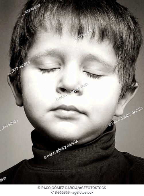 Little boy with eyes closed
