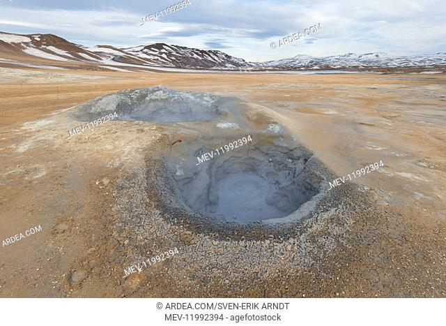 Hverir is a geothermal area near Namafjall with boiling mudpools and steaming fumaroles - Iceland