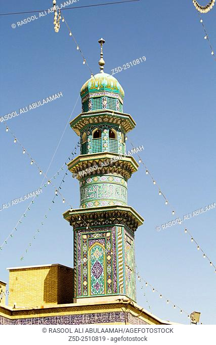 picture of minaret of The shrine of Fatima Almasomh , It is the shrine to the Shiite sect and is located in the city of Qom