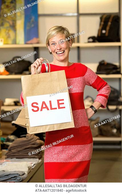 Woman has made a bargain buy in a boutique