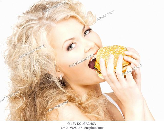 health, food, diet and beauty concept - beautiful happy woman with burger