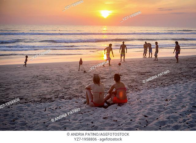 Locals and visitors gather at Santa Teresa beach to watch the sunset, Costa Rica
