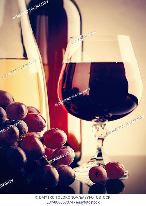 Wine and grape. Winery still life on the glass with reflections