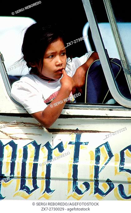 Portrait of a girl in the window of a bus between Oaxaca city and Ayutla, Mexico