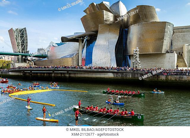 plastic ducks race in Nervion river. Near Guggenheim Museum. Bilbao. Biscay, Basque Country, Spain, Europe