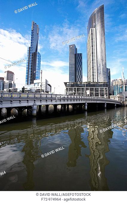 Skyscrapers including the Eureka Tower and the historic Queens Bridge 1889 reflected in Yarra River, Melbourne, Victoria, Australia