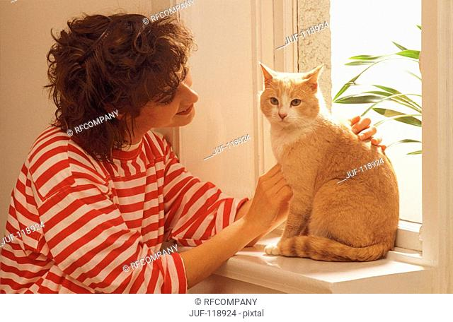 young woman with domestic cat