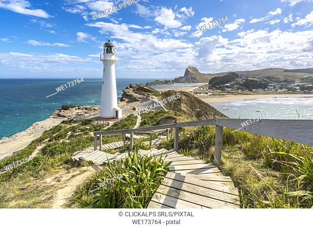 Castlepoint lighthouse and Castle Rock in the background. Castlepoint, Wairarapa region, North Island, New Zealand