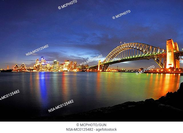 Skyline of Sydney with Sydney Opera House and Harbor Bridge during the blue hour, Sydney, New South Wales, Australia, February 2007