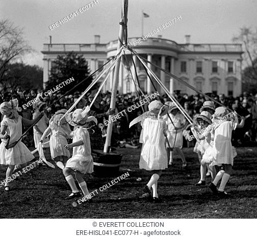 Children dance around a maypole at the White House Easter Celebration on April 1, 1929. First Lady Lou Hoover replaced the Easter Egg Roll with Folk Dancing