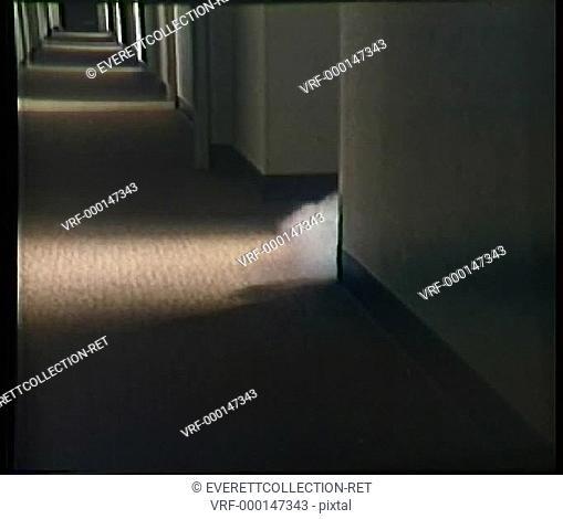 Smoke streaming out of corner through hallway