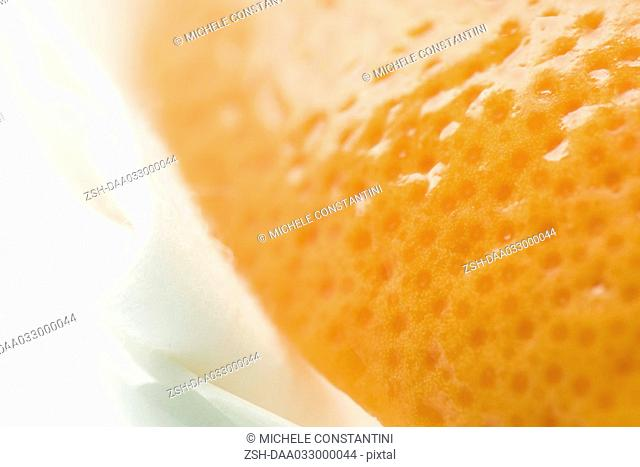 Orange and cosmetic pad, extreme close-up