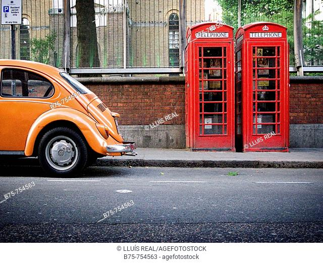Orange Wolsvagen and two traditional phone boxes in Wardour Street, close to Piccadily Circus, Central London, England, U.K
