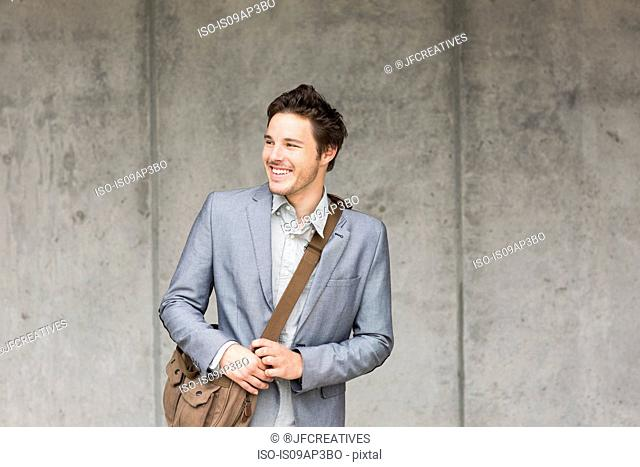 Businessman looking away, portrait