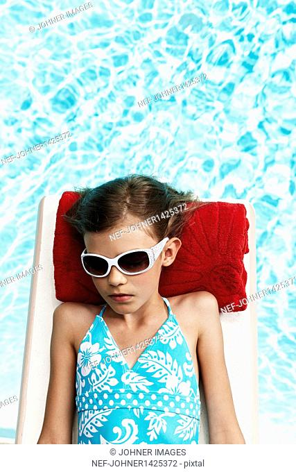 Girl relaxing on pool raft