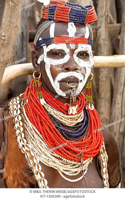 Young Karo woman with lots of colorful necklaces and Cowry shells , Omo river valley, Southern Ethiopia