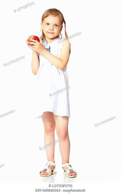 Little girl with an apple. Concept of healthy eating, happiness, Happy childhood, harvesting. Isolated on white background