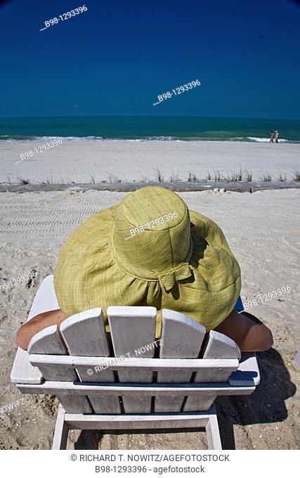 Sitting in a beach chair. Gasparilla Island Inn and Club Swimming pool and beach, USA