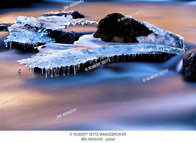 Djupin river, with ice and rocks at sunrise, Vik, Iceland