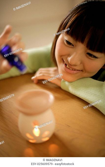Woman and an aromatherapy burner