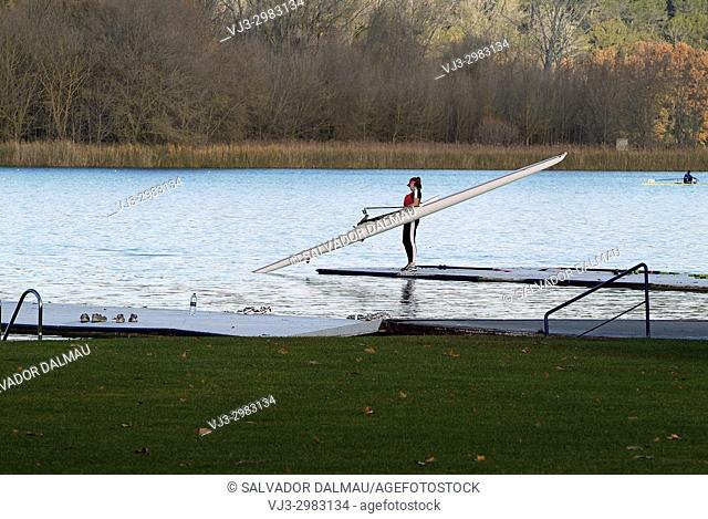 canoe diverting water from the pirogue, Lake of Banyoles, girona, catalonia