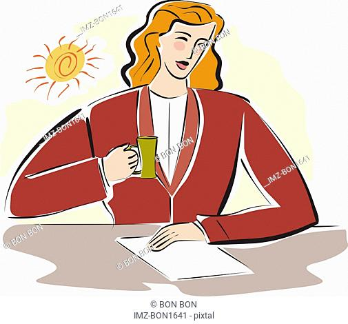 A business woman looking over documents